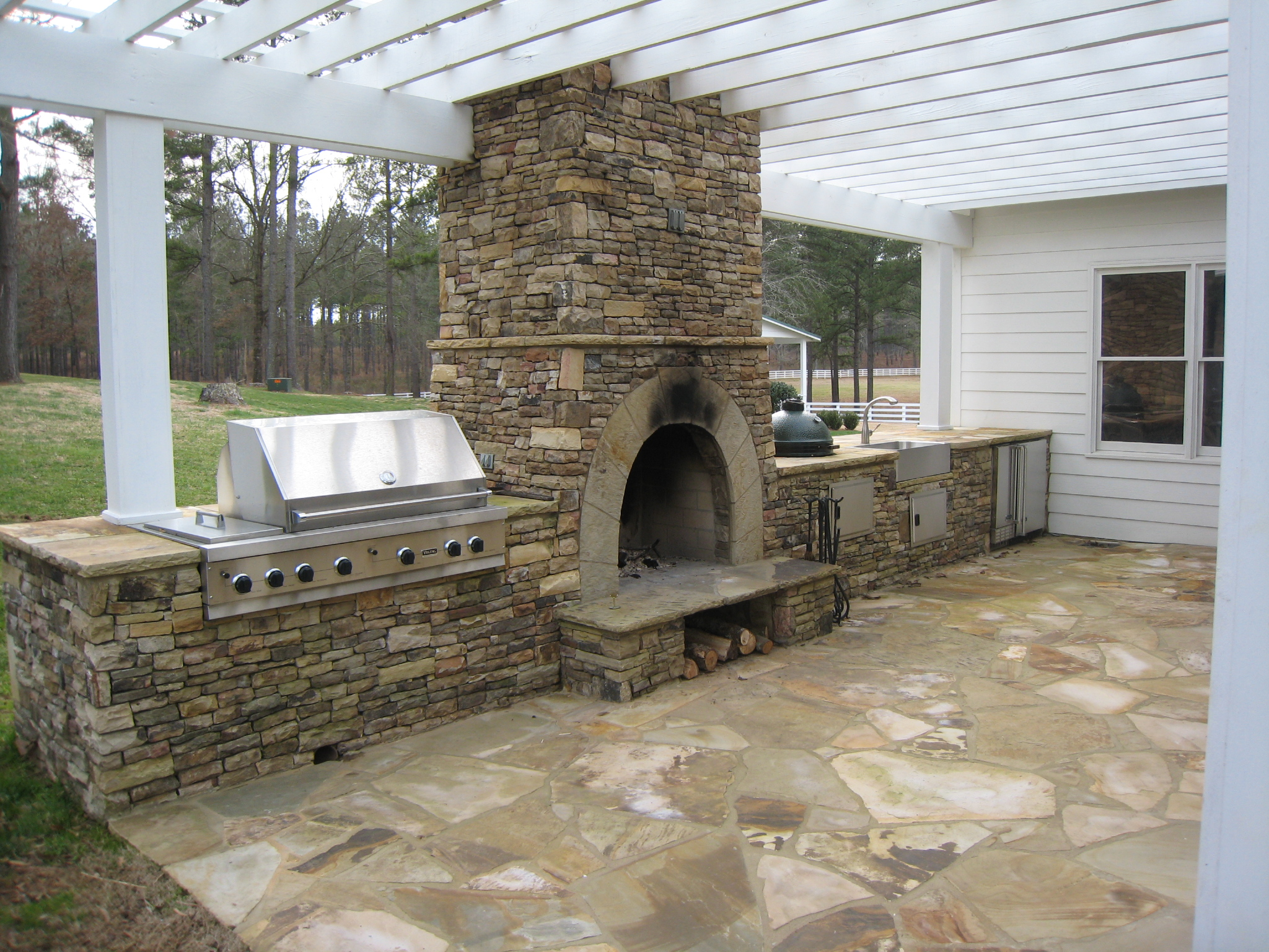 Outdoor kitchens stone bbq design davel construction for Outdoor kitchen bbq designs