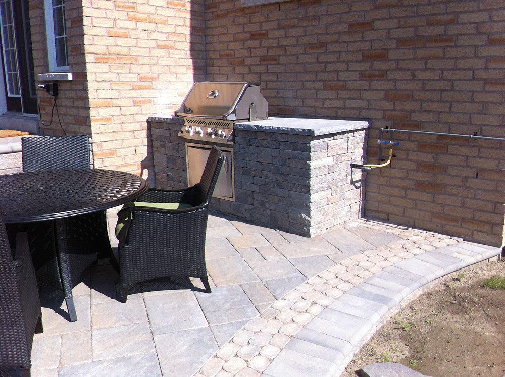 Outdoor kitchens stone bbq design davel construction for Outdoor kitchen contractors