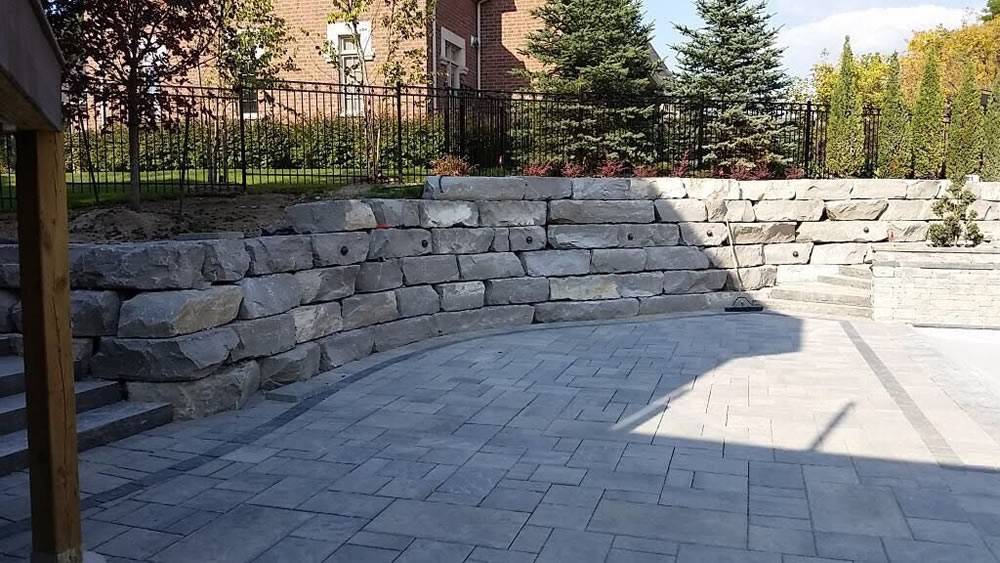 Stone patio installed by Davel