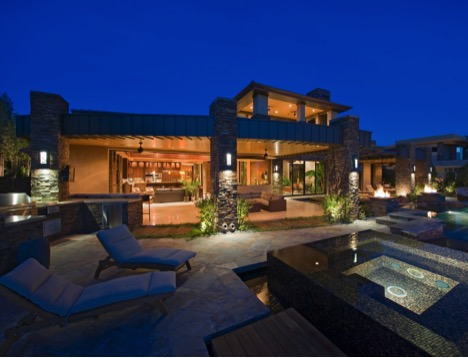 home with interlock patio and exterior lighting