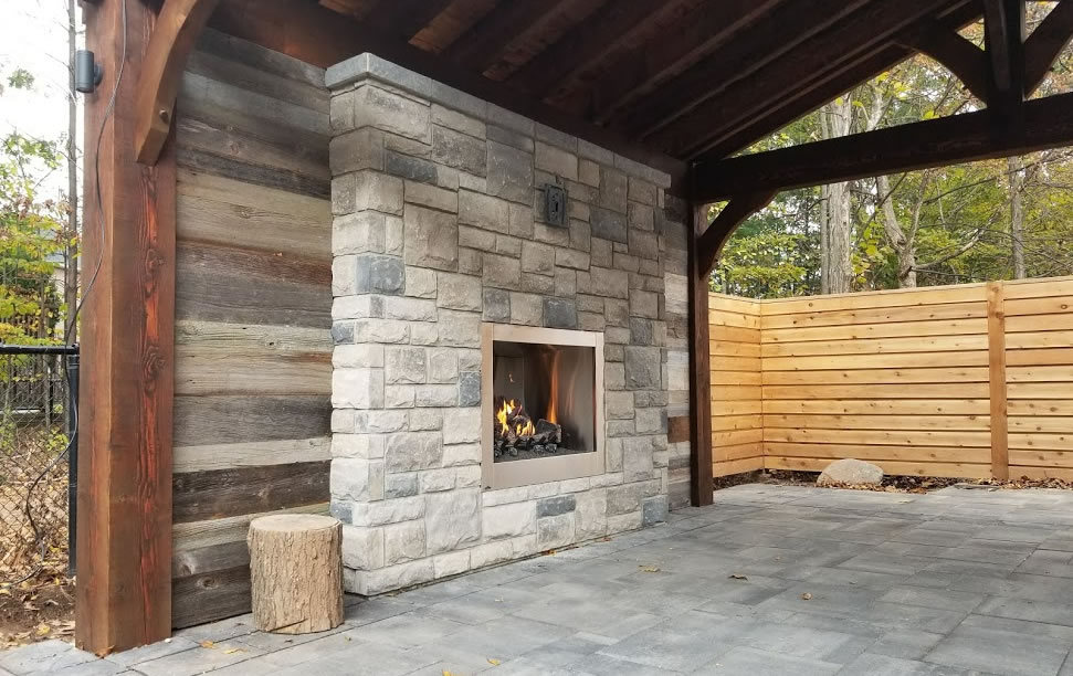 Stone fireplace in a beautiful backyard