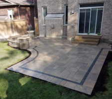 Backyard patio installed by Davel Construction