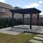 Stone patio and Pergola by Davel Construction