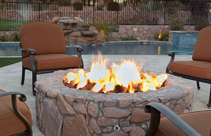 outdoor firepit near pool