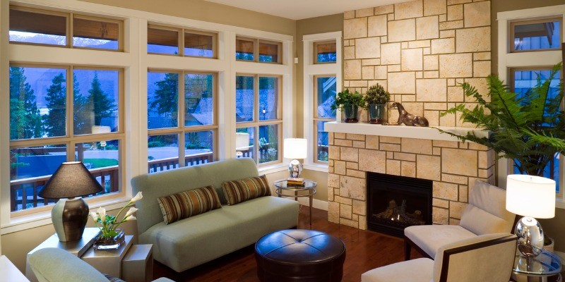 Tan coloured Fireplace and mantel in living room